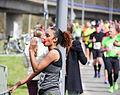 Standing drinking sportswoman during Marathon Rotterdam 2015.jpg