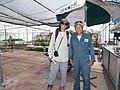 Starr-170627-0209-Lactuca sativa-Kim and Thai Worker Hin-Hydroponics Greenhouse Sand Island-Midway Atoll (35649293873).jpg