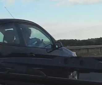 Texting while driving - Driver texting while driving a car in the United Kingdom