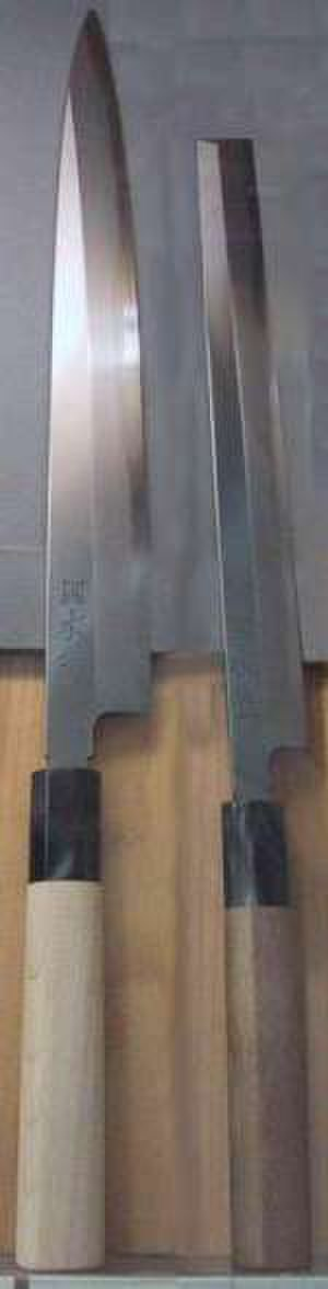 Kitchen knife - Japanese knives, displaying a pointed tip and a straight blade.