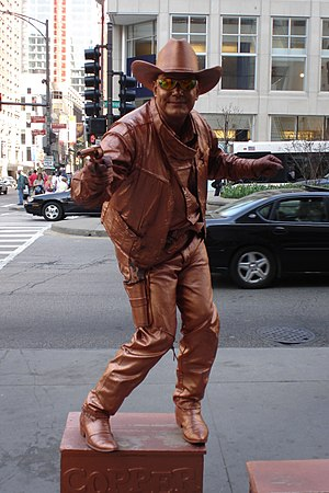 """Living statue - """"The Copper Cowboy"""", a living statue performer in Chicago"""
