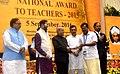 The President, Shri Pranab Mukherjee presenting the National Award for Teachers-2015 to Shri G. Vijayan Nair (Kerala), on the occasion of the 'Teachers Day', in New Delhi.jpg