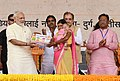 The Prime Minister, Shri Narendra Modi distributing the laptopscertificatescheques etc. to the beneficiaries under various schemes, at a function, in Bhilai, Chhattisgarh (1).JPG