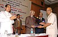 "The Vice President, Mohammad Hamid Ansari presenting the Life Time Achievements Award to Prof. Dr. Ram Mohan Tiwari at the ""2nd CARF Annual Awards Function"", in Mumbai on March 31, 2008.jpg"