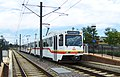 Three-car train at Littleton-Mineral stn of RTD light rail, cropped.jpg