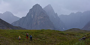 Gates of the Arctic National Park and Preserve - Hikers in the Itkillik River drainage, a group of tilted sedimentary peaks in the central Brooks Range