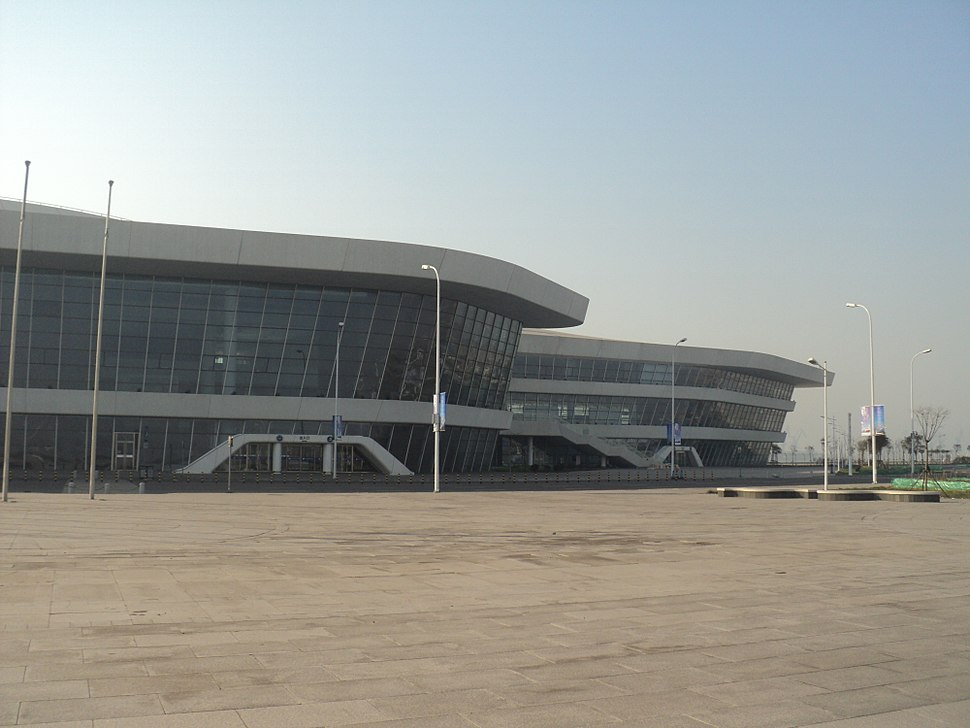 partial view of a curvy white building with long airport-style windows