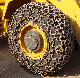 Loader (equipment) - Traction chains on a wheel loader