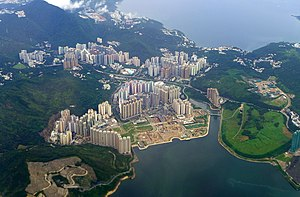Tseung Kwan O - Aerial view of Tseung Kwan O, with Tseung Kwan O Industrial Estate on the right. The waters at the top of the picture are part of Port Shelter.
