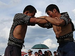 Two Daur men wrestling.jpg