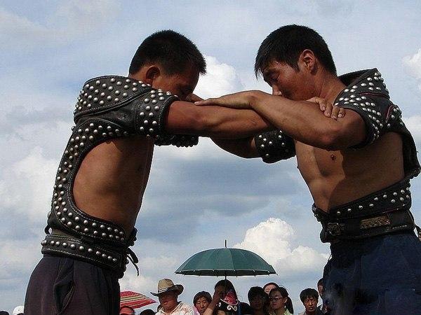 Two Daur men wrestling