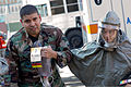 U.S. Air Force Capt. Jennilyn Estell, right, a dentist with the 374th Dental Squadron, guides Senior Airman Fausto Rojas, a simulated patient with the 374th Medical Support Squadron, to a decontamination area 111104-F-PM645-070.jpg
