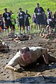 U.S. Air Force Col. Patrick Cobb, the commander of the 102nd Intelligence Wing, Massachusetts Air National Guard, crawls through the barbed wire and mud obstacle at the Tough Mudder Boston 2013 event in Gilford 130601-Z-FW757-220.jpg