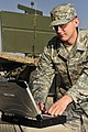 U.S. Air Force Senior Airman Scott Lacey, a ground radar systems maintainer with the 727th Expeditionary Air Control Squadron, inspects an AN-TPS-75 radar system at an undisclosed location in Southwest Asia 130121-F-ME639-214.jpg