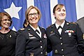 U.S. Army Sgt. Sarah M. Deckert, right, the Enlisted Aide of the Year awardee, stands on stage next to Lt. Gen. Patricia D. Horoho, the commanding general of U.S. Army Medical Command, during the USO 131113-D-HU462-150.jpg