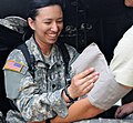 U.S. Army Spc. Kristana Levit, left, a medic with the 144th Medical Detachment, prepares to take the blood pressure of a Soldier showing symptoms of heat exhaustion May 14, 2013, in Las Marias, El Salvador 130514-A-EX794-005.jpg