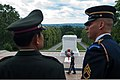 U.S. Army Staff Sgt. Michael Buelna, right, explains the changing of the guard at the Tomb of the Unknowns to Commander-in-Chief of the Royal Thai Army Gen. Prayuth Chan-ocha at Arlington National Cemetery, Va 130606-A-AO884-309.jpg