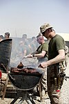 U.S. Marine Corps staff noncommissioned officers with Combat Logistics Company 28, Combat Logistics Regiment 2 prepare meat for their company barbecue at Camp Dwyer in Helmand province, Afghanistan, April 3 130403-M-KS710-108.jpg
