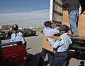 U.S. Naval Sea Cadet Kendall Kent moves a box of food.jpg