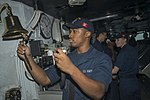 U.S. Navy Boatswain's Mate Seaman Telly Myles marks the half-hour with bells on the bridge of the aircraft carrier USS Harry S. Truman (CVN 75) in the Gulf of Oman Oct. 7, 2013 131007-N-GR168-019.jpg