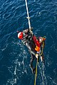 U.S. Navy Seaman Ian Soper, a rescue swimmer assigned to the guided missile destroyer USS Truxtun (DDG 103), is hoisted aboard the ship during a man overboard drill in the Atlantic Ocean Dec. 12, 2013 131212-N-EI510-092.jpg