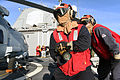 U.S. Sailors prepare to combat a simulated fire during a simulated helicopter crash on the flight deck aboard the guided missile cruiser USS Vicksburg (CG 69) as part of a damage control training team scenario 140924-N-WW127-503.jpg