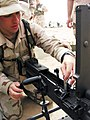 US Navy 030412-N-1050K-014 Gunner's Mate 3rd Class Jeff Healey, 23, from Albuquerque, N.M., tests the barrel alignment of the M2 .50 caliber machine gun.jpg