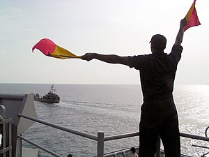 Signalman - Signalman Seaman practices his semaphore.