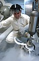 US Navy 040630-N-8213G-046 Machinist Mate 2nd Class David Gayton, of Kingston, NY, monitors the Fleet Cryogenic Sampler 2000 while it takes a sample of liquid oxygen aboard USS Ronald Reagan (CVN 76).jpg