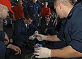 US Navy 041115-N-5837R-143 Sailors aboard USS Abraham Lincoln (CVN 72) receive a walk through in Chemical, Biological, and Radiological (CBR) detection.jpg