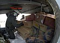 US Navy 050103-N-9951E-030 Aviation Electronics Technician 2nd Class J.D. Schapp and Senior Chief Aviation Structural Mechanic Ray Adams position cargo in the cabin of their MH-60S Knighthawk helicopter.jpg