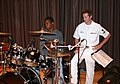 US Navy 050615-N-6525H-032 Musician 3rd Class Ryan Bennett, the drummer for Rhode Island Sound, a Top-40 ensemble of Navy Band Northeast, mentors a high school student following a performance for students at Charleston High Sch.jpg