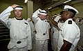 US Navy 050629-N-9693M-252 Midshipman 1st Class Kasisi Harris, right, instructs a Midshipman candidate on the proper wearing of his cover at the United States Naval Academy in Annapolis, Md.jpg