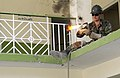 US Navy 051109-F-2729L-007 U.S. Navy Steelworker Constructionman Casey Good, assigned to Naval Mobile Construction Battalion Seven Four (NMCB-74), lights a torch to cut through railing.jpg
