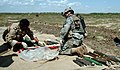 US Navy 060407-N-8252B-034 Sgt. Robert Longacre, Company C, 1st Battalion, 67th Armored Regiment, and an Iraqi Army soldier organize a cache.jpg