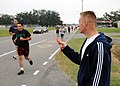 US Navy 061102-N-7427G-003 Chief Electricians Mate Aaron Niedbalski monitors the time during the 1.5 mile run portion of the Physical Fitness Assessment (PFA) held aboard Naval Air Station Joint Reserve Base New Orleans.jpg