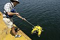 US Navy 070611-N-7676W-121 Franz Hoover, Massachusetts Institute of Technology, assists the Bluefin Hovering Autonomous Underwater Vehicle (HAUV) prior to a demonstration of its capabilities for close-range hull inspection duri.jpg