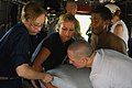 US Navy 080913-N-4515N-083 Service members embarked aboard the amphibious assault ship USS Kearsarge (LHD 3) load supplies onto helicopters for delivery to areas affected by recent hurricanes in Haiti.jpg