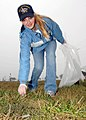 US Navy 090327-N-6524M-002 Storekeeper Seaman Kathrine Johnson collects trash in Buckroe Beach park during a community relations project conducted by sailors assigned to the nuclear-powered aircraft carrier USS Enterprise (CVN.jpg
