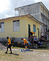 US Navy 090415-N-9995B-003 U.S. military service members assigned to high speed vessel Swift (HSV 2), Southern Partnership Station, and Beyond the Horizon 2009 clean and paint a schoolhouse during a community service project.jpg