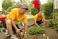 US Navy 090526-N-7975R-008 Sailors work with Executive Director Brenda Spratt to enhance the landscaping at the Two Doors Community Resource Center.jpg