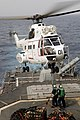 US Navy 090716-N-9301D-255 Air Department personnel aboard the guided-missile cruiser USS Anzio (CG 68) connect a lift cable to a SA-330 Puma helicopter assigned to the combat stores ship USNS San Jose (T-AFS 7) during a vertic.jpg