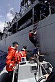 US Navy 090728-N-7092S-065 U.S. Coast Guard personnel board the guided-missile frigate USS Kauffman (FFG 59) for a luncheon.jpg