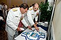US Navy 090924-N-2728S-116 Rear Adm. William G. Sizemore II, arriving Chief of Naval Air Training, left, and Rear Adm. Mark D. Guadagnini, departing Chief of Naval Air Training, take part in the traditional cake cutting.jpg