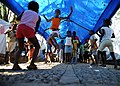 US Navy 100222-N-5961C-009 Haitian children enjoy jumping rope under the shelter of a tarp in their temporary neighborhoods.jpg