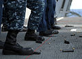 US Navy 100305-N-4408B-036 Sailors assigned to the Weapons Department of the aircraft carrier USS George H.W. Bush (CVN 77) approach the firing line during live-fire weapons qualifications.jpg