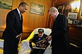 US Navy 100326-N-5549O-237 Secretary of the Navy (SECNAV) the Honorable Ray Mabus, right, and Massachusetts Gov. Deval Patrick visit with WWII veteran and USS Indianapolis survivor Robert Bunai at his home.jpg