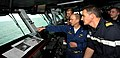 US Navy 100708-N-6362C-315 Capt. Joe Clarkson points out features of the flight deck to Capt. Gilles Boidevezi during a one-day embark aboard USS Harry S. Truman (CVN 75).jpg