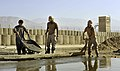US Navy 101123-N-6436W-070 Seabees assigned to Naval Mobile Construction Battalion (NMCB) 40 work with Afghani contractors to place concrete for he.jpg