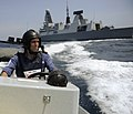US Navy 110628-N-MY642-402 A sailor pilots a rigid-hull inflatable boat for the transport of a British visit, board, search and seizure team.jpg